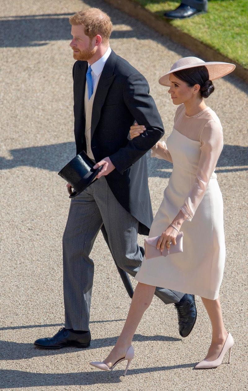 Prince Harry and Meghan Markle leave Prince Charles' 70th Birthday Garden Party at Buckingham Palace. Photo: Getty Images