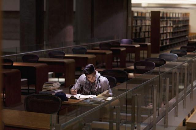 A student studies in a library at night. (Photo: Sam Edwards/Getty Images)