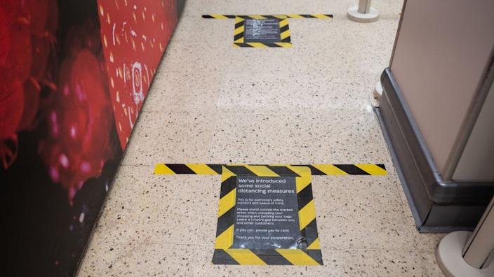 Tesco has marked the floor to help shoppers keep their distance from one another