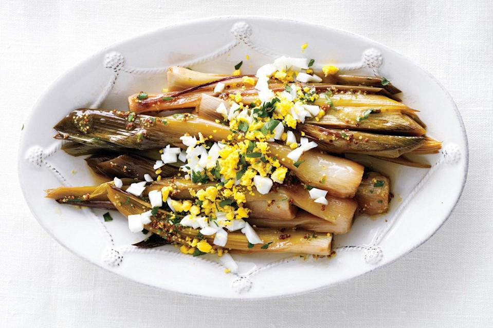 """These buttery leeks were designed to be a side dish. The only problem? They often steal the spotlight from the entree. <a href=""""https://www.epicurious.com/recipes/food/views/leeks-vinaigrette-367716?mbid=synd_yahoo_rss"""" rel=""""nofollow noopener"""" target=""""_blank"""" data-ylk=""""slk:See recipe."""" class=""""link rapid-noclick-resp"""">See recipe.</a>"""