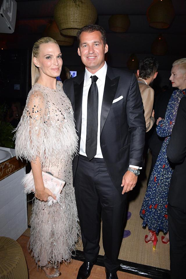 Molly Sims, in Monique Lhuillier, and producer Scott Stuber attend the Hollywood Foreign Press Association's 2017 Cannes party (Photo: Getty Images)