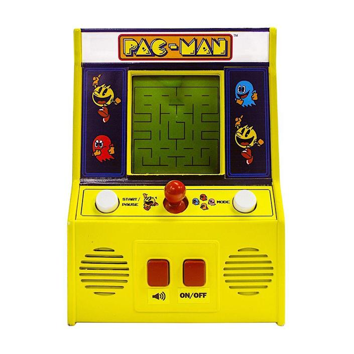 """<p><a class=""""link rapid-noclick-resp"""" href=""""https://www.amazon.com/Arcade-Classics-Pac-Man-Retro-Mini/dp/B01DK2WO1C/ref=sr_1_1_sspa?tag=syn-yahoo-20&ascsubtag=%5Bartid%7C10063.g.34738490%5Bsrc%7Cyahoo-us"""" rel=""""nofollow noopener"""" target=""""_blank"""" data-ylk=""""slk:BUY NOW"""">BUY NOW</a><br></p><p>Gamers didn't have the luxury of playing <em>Pac-Man</em> on their couches when it was released by Midway Games in the U.S. in 1980. Instead, they were saving their quarters to play at arcades around the country. In its first year alone, <a href=""""http://sandyhistorical.org/2015/07/28/the-legend-of-the-man-of-pac/"""" rel=""""nofollow noopener"""" target=""""_blank"""" data-ylk=""""slk:Pac-Man grossed $1 billion in quarters"""" class=""""link rapid-noclick-resp"""">Pac-Man grossed $1 billion in quarters</a>.</p>"""