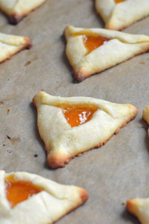 """<p>These buttery triangles are filled with perfectly tart apricot jam, which is seriously addicting. See for yourself. </p><p><a href=""""https://www.onceuponachef.com/recipes/apricot-hamantaschen.html"""" rel=""""nofollow noopener"""" target=""""_blank"""" data-ylk=""""slk:Get the recipe from Once Upon a Chef »"""" class=""""link rapid-noclick-resp""""><em>Get the recipe from Once Upon a Chef »</em></a></p>"""