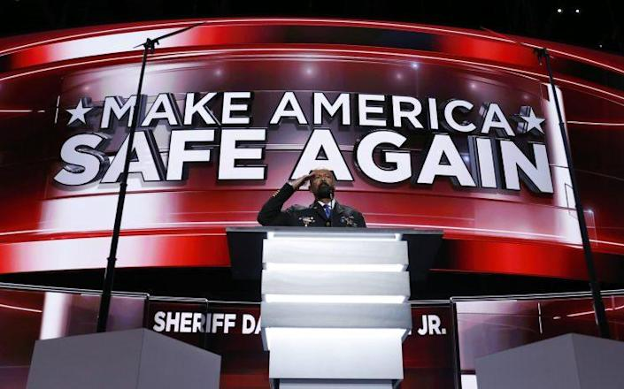 David Clarke salutes as he addresses the delegates during the opening day of the Republican National Convention in Cleveland. (Photo: Carolyn Kaster/AP)
