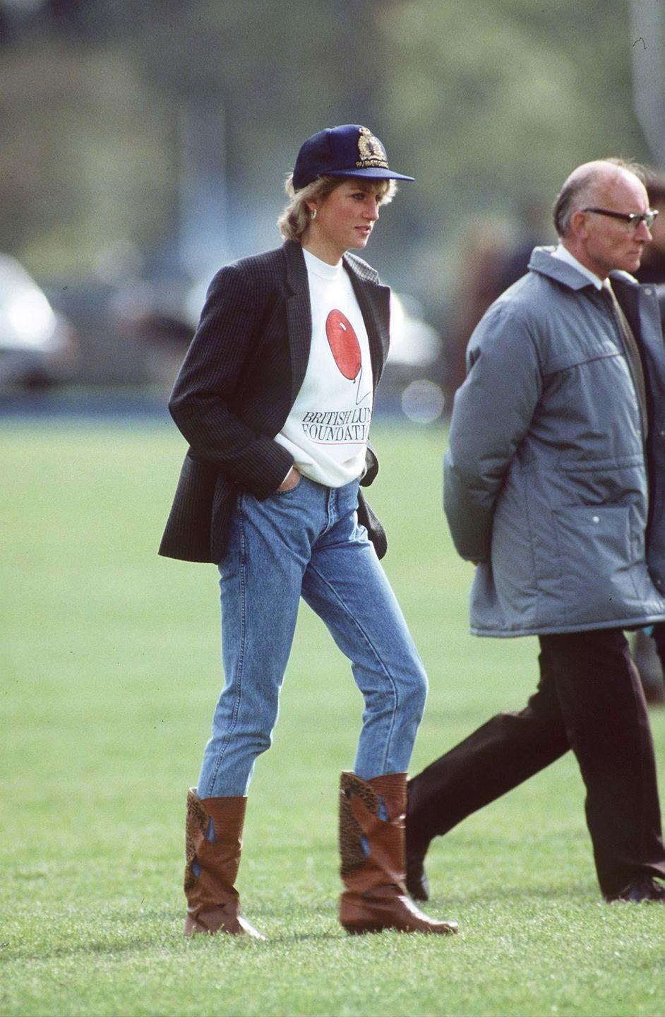 <p>Princess Diana at a polo match, showing how gloriously acceptable jeans had become. </p>