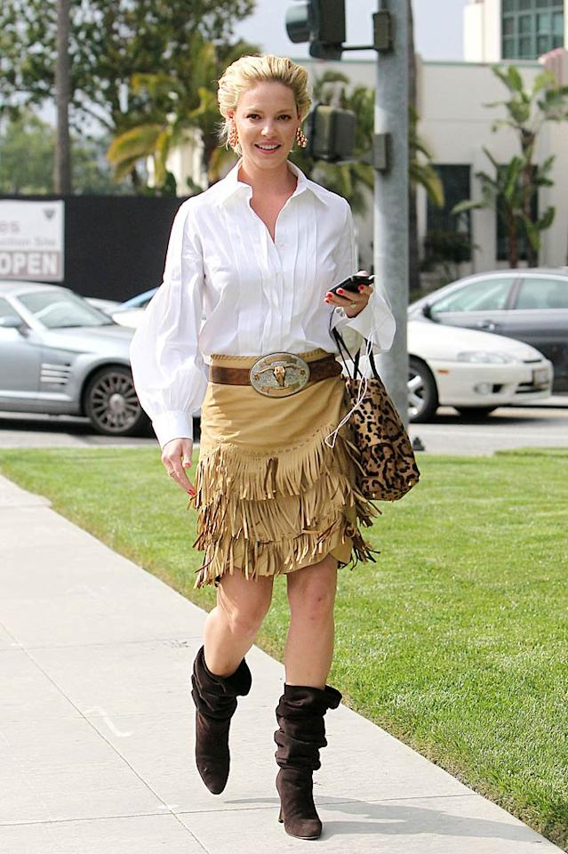 "18. Former ""Grey's Anatomy"" star Katherine Heigl -- in a disastrous Ralph Lauren ensemble complete with white bell-sleeved blouse, $2,500 fringed leather skirt, bull skull belt, and brown slouchy boots -- en route to a business meeting in Beverly Hills. (04/18/2011)"