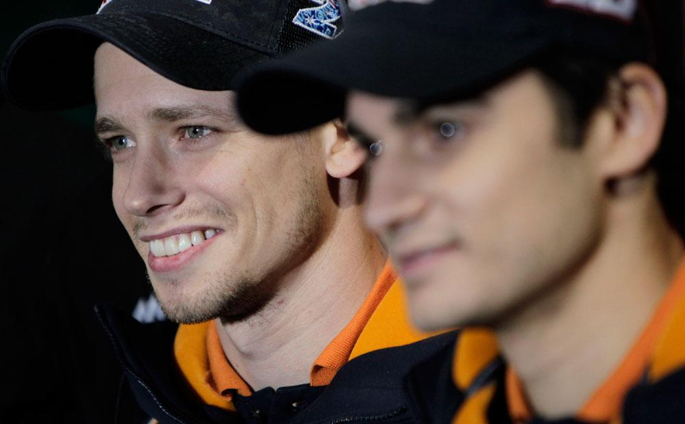 World MotoGP Champion Casey Stoner from Australia and teammate Dani Pedrosa pose for photographers during the presentation of the Repsol Honda Moto GP Team at the 'Palacio de los Deportes' in Madrid, Spain on Saturday, March 3, 2012.