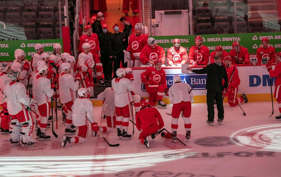 The Detroit Red Wings listen to head coach Jeff Blashill before a scrimmage Tuesday, Jan. 5, 2021 at Little Caesars Arena in Detroit.