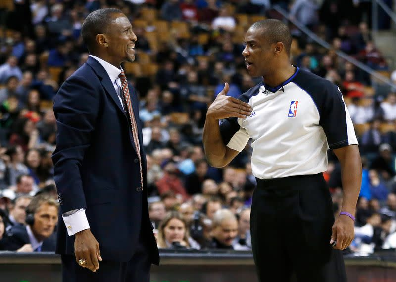 FILE PHOTO: Raptors' head coach Casey complains to referee Brown during a break in play against the Jazz during their NBA basketball game in Toronto
