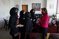 Martha Delgado, Undersecretary for Multilateral Affairs and Human Rights at the Ministry of Foreign Relations of Mexico, talks with members of the Afghan all-girls robotics team, after an interview in Mexico City, Wednesday, Aug. 25, 2021. After international efforts and coordination from a diverse group of volunteers to evacuate the team, the girls are begging the international community to help get their families to safety amid evacuations for people fleeing the Taliban takeover as the U.S. pulls out. (AP Photo/Eduardo Verdugo)