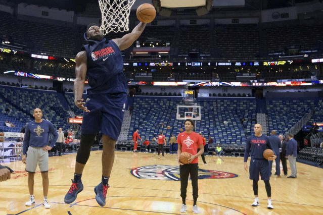 New Orleans Pelicans forward Zion Williamson goes up for a dunk before the start of an NBA basketball game against the Chicago Bulls in New Orleans, Wednesday, Jan. 8, 2020. Williamson is not scheduled to play. (AP Photo/Matthew Hinton)