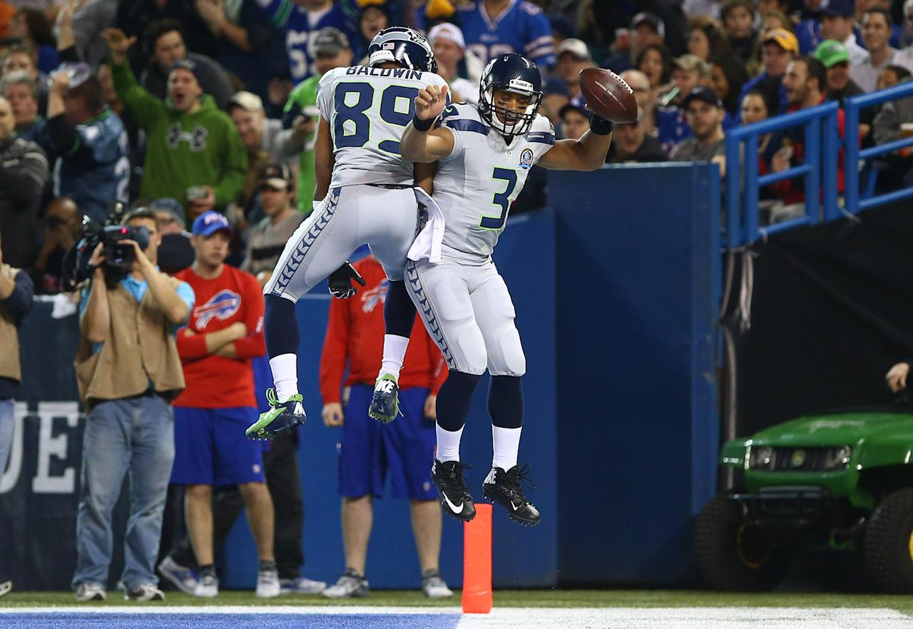 TORONTO, ON - DECEMBER 16: Russell Wilson #3 of the Seattle Seahawks celebrates his rushing touchdown with Doug Baldwin #89 during an NFL game against the Buffalo Bills at Rogers Centre on December 16, 2012 in Toronto, Ontario, Canada. (Photo by Tom Szczerbowski/Getty Images)