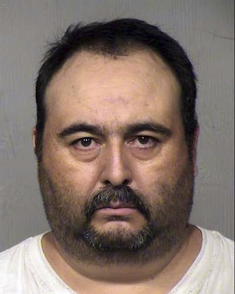 This April 2019 mugshot provided by the Maricopa County Sheriff's Office in Phoenix shows Jorge Murrieta. Murrieta is accused of forcing a day laborer to have sex with his wife at gunpoint and filming the encounter to extort him. (Maricopa County Sheriff's Office via AP)