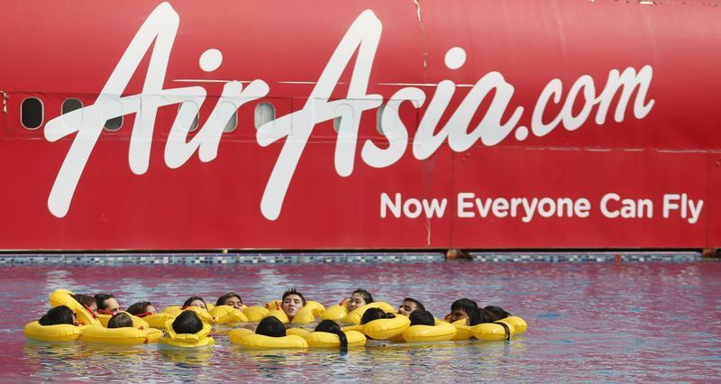 The logo of Malaysia's low-cost airline AirAsia Berhad is pictured on a structure as its staff undergo training at its academy in Sepang