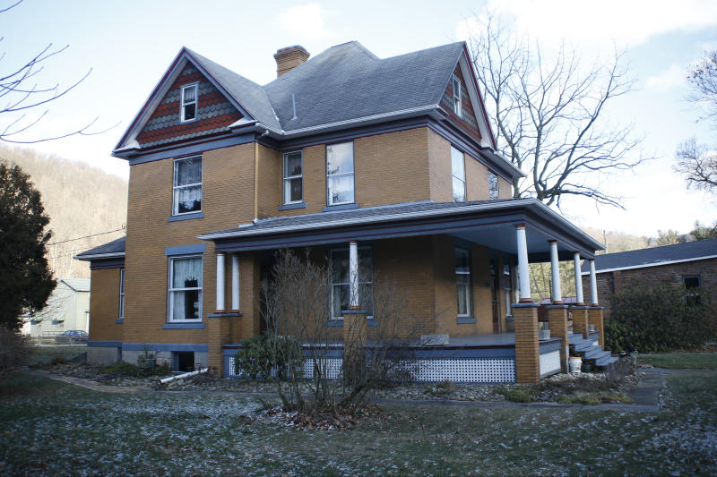 "The house used as the home of psychotic killer Buffalo Bill in the 1991 film ""The Silence of the Lambs"" is seen for sale on Monday, Jan. 11, 2016 in Perryopolis, Pa. Scott and Barbara Lloyd listed the house last summer, but they've dropped the asking price from $300,000 to $250,000. The three-story Victorian was the second-most clicked home on Realtor.com last year, but no serious buyers. (AP Photo/Keith Srakocic)"