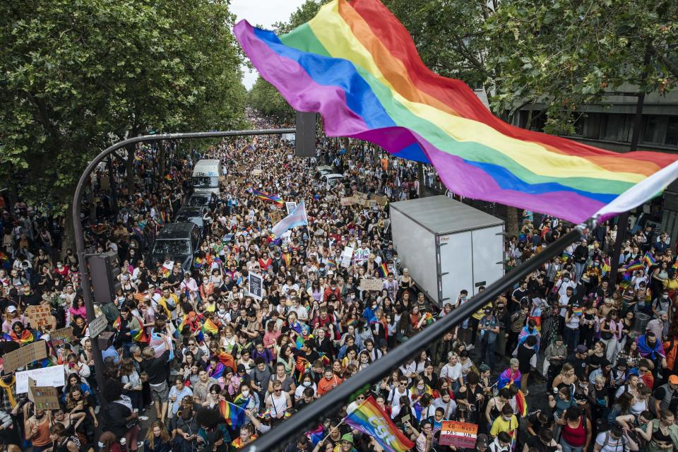 Crowds are seen at the annual Gay Pride march in Paris, Saturday, June 26, 2021. This year's march in Paris comes amid widespread fury and concern in Europe about legislation in EU-member nation Hungary that will ban showing content about LGBT issues to children. (AP Photo/Lewis Joly)