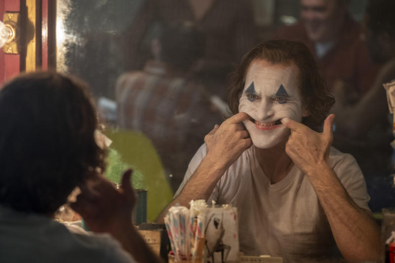 """This image released by Warner Bros. Pictures shows Joaquin Phoenix in a scene from the film """"Joker."""" (Niko Tavernise/Warner Bros. Pictures via AP)"""