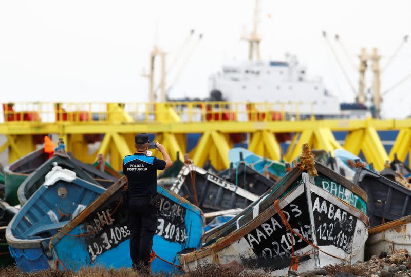 Boats used by migrants to reach the Canary Islands coasts, are seen piled up at Arinaga port, in Aguimes