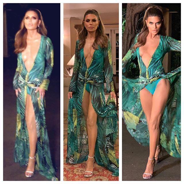 """<p>And that wasn't the only time she channeled her inner J.Lo: the wig-loving reality star also dressed up in the <a href=""""https://people.com/style/jennifer-lopez-reflects-on-rewearing-her-famous-versace-dress/"""" rel=""""nofollow noopener"""" target=""""_blank"""" data-ylk=""""slk:singer's iconic Versace gown"""" class=""""link rapid-noclick-resp"""">singer's iconic Versace gown</a> for Halloween in 2019. </p>"""