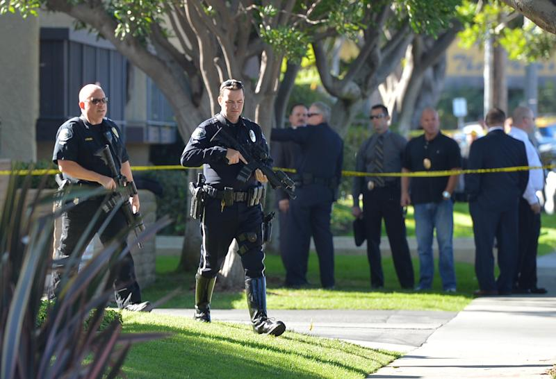 Torrance police and fire respond to a call at Golden West Tower on Maricopa Street in Torrance, Calif., Tuesday afternoon, Nov. 20, 2012. Three people died Tuesday in what appears to be a double murder-suicide at the senior citizens' high-rise south of Los Angeles, police said. (AP Photo/The Daily Breeze, Robert Casillas)