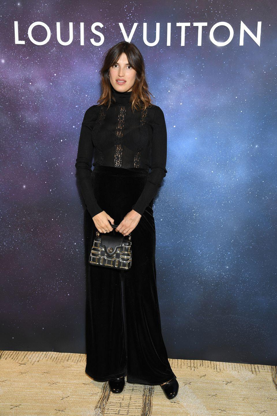 <p><strong>28 September </strong>Jeanne Damas dressed for autumn in chic velvet trousers, accessorised with a Louis Vuitton handbag. </p>