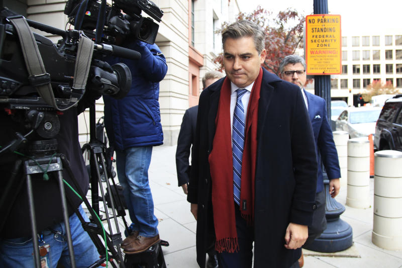 "CNN's Jim Acosta walks into federal court in Washington, Wednesday, Nov. 14, 2018, to attend a hearing on legal challenge against President Donald Trump's administration. Trump's administration contends it has ""broad discretion"" to regulate press access to the White House as it fends off a legal challenge from CNN and other outlets over the revocation of Acosta's ""hard pass."" (AP Photo/Manuel Balce Ceneta)"