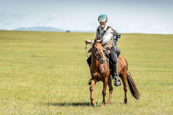 PHOTO: Robert Long, known by the nickname Cowboy Bob, who is the oldest winner of Mongol Derby, the 1,000 km world's longest horse race, sits on his horse near Jargalt, Mongolia, Aug. 14, 2019. (The Adventurists/Mongol Derby/Sarah Farnsworth via Reuters)
