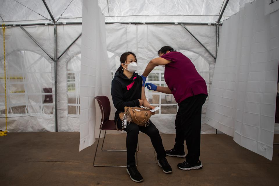 A nurse administers the Moderna Covid-19 vaccine at Kedren Community Health Center, in South Central Los Angeles, California on February 16, 2021. (Photo by Apu GOMES / AFP) (Photo by APU GOMES/AFP via Getty Images)