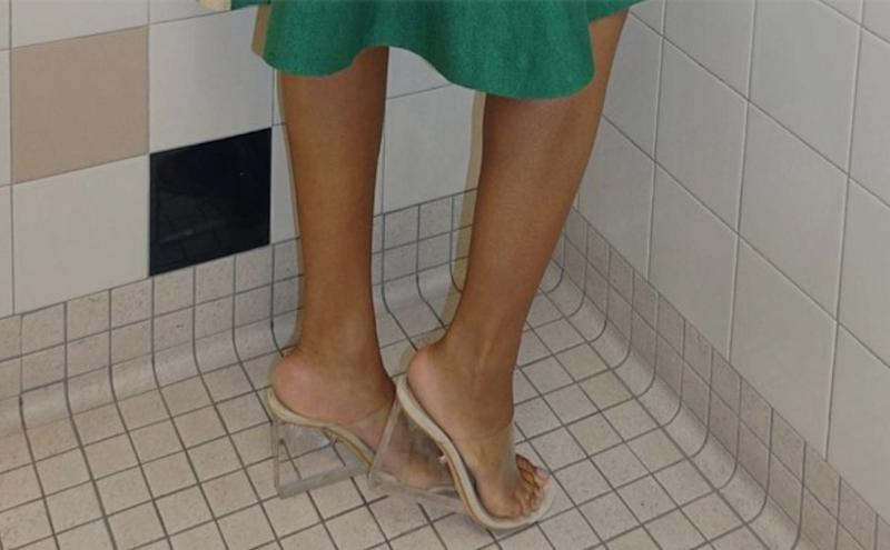 Beyonce's feet in Kanye West's Yeezy mules.