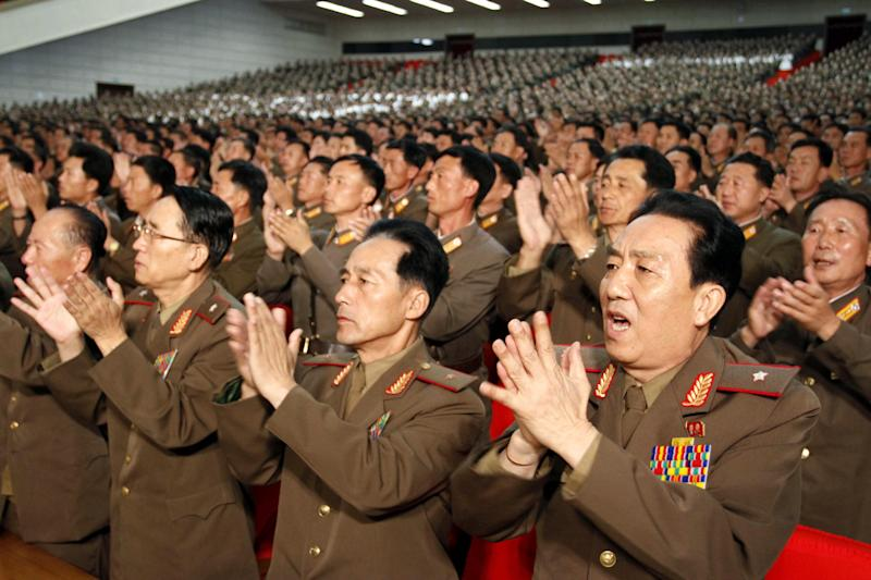 North Korean soldiers applaud during a meeting at the April 25 House of Culture announcing North Korean leader Kim Jong Un's new title of marshal, Wednesday, July 18, 2012, in Pyongyang, North Korea. The decision to award the top title to Kim, who already serves as supreme commander of the Korean People's Army, was made Tuesday by the nation's military, government and political leadership, state media said in a special bulletin. The move solidifying his standing comes seven months into Kim's rule. (AP Photo/Kim Kwang Hyon)