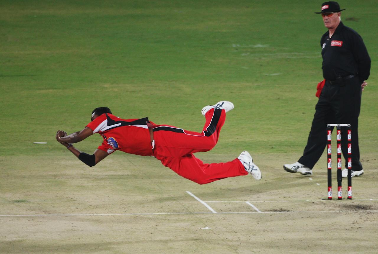 HYDERABAD, INDIA - OCTOBER 22:  Sherwin Ganga of Trinidad takes the catch of Andrew Puttick of the Cobras off of his own bowling during the Airtel Champions League Twenty20 second semi-final match between the Cape Cobras v Trinidad and Tobago at the Rajiv Gandhi Internqtional Cricket Stadium on October 22, 2009 in Hyderabad, India.  (Photo by Daniel Berehulak - GCV/GCV via Getty Images)