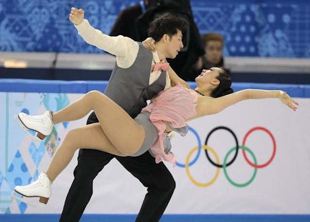 Huang Xintong and Zheng Xun of China compete in the team ice dance short dance figure skating competition at the Iceberg Skating Palace during the 2014 Winter Olympics, Saturday, Feb. 8, 2014, in Sochi, Russia. (AP Photo/Vadim Ghirda)