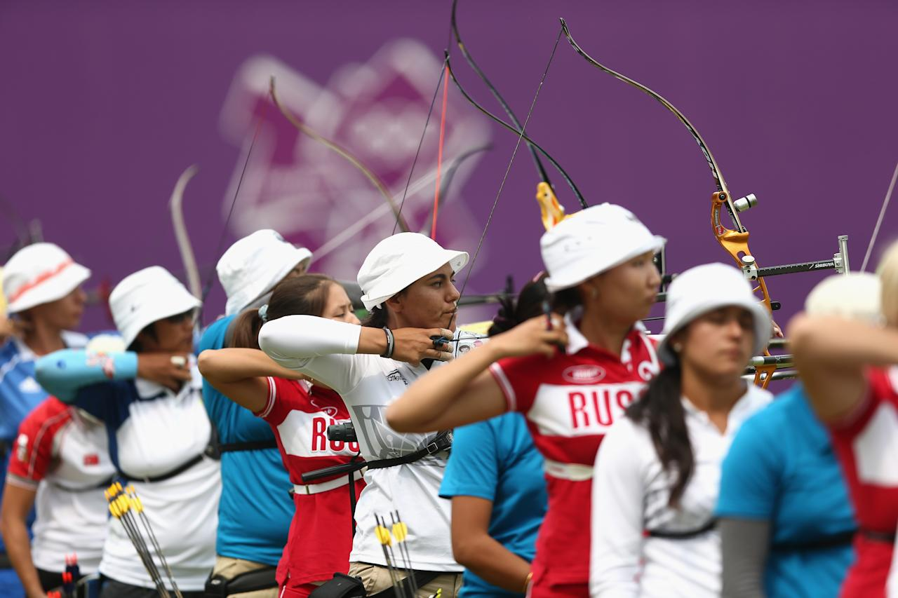 LONDON, ENGLAND - JULY 27:  Competitors in action during the Archery Ranking Round on Olympics Opening Day as part of the London 2012 Olympic Games at the Lord's Cricket Ground on July 27, 2012 in London, England.  (Photo by Paul Gilham/Getty Images)