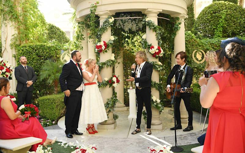 Sir Rod Stewart (R) sings during the wedding of Sharon Cook (C) and Andrew Aitchison (L) from Liverpool, England. The wedding was nearly cancelled due to the Thomas Cook Bankruptcy. Caesars Palace and Delta Air Lines flew the couple and their guests to Las Vegas as originally planned. The Wedding took place at Caesars Palace on October 02, 2019 in Las Vegas, Nevada.   Denise Truscello/WireImage