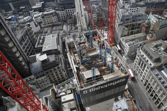 A view looking down from the top of the north central column of the 8 Bishopsgate development in London, Thursday, April 1, 2021. When the pandemic struck, about 540,000 workers vanished from London's financial hub almost overnight. Developers of 8 Bishopsgate, are confident that when construction ends late next year, workers and firms will return to fill all 50 floors of the gleaming new office space. (AP Photo/Alastair Grant)
