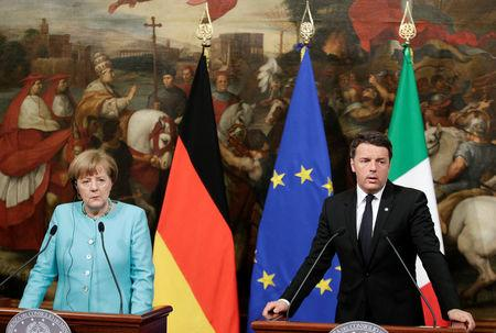 Italian Prime Minister Matteo Renzi (R) speaks next to German Chancellor Angela Merkel as they lead a news conference at Chigi palace in Rome, Italy May 5, 2016. REUTERS/Max Rossi