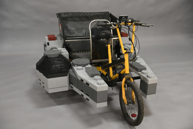 This is the Lego <em>Millennium Falcon</em> pedicab you're looking for. (Photo: Jessica Hill/AP Images for Lego, Inc)
