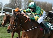 History-maker: Rachael Blackmore rides Minella Times to Grand National victory
