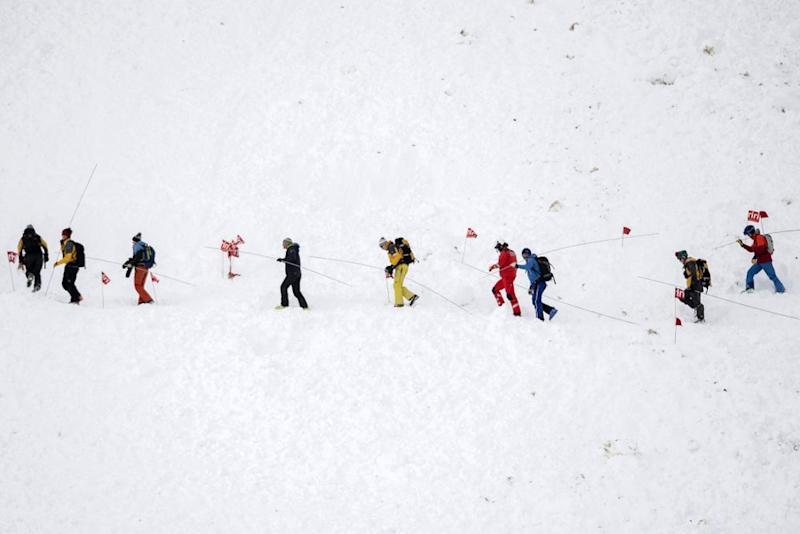 Search teams look for skiers caught in the avalanche | Urs Flueeler/EPA-EFE/Shutterstock