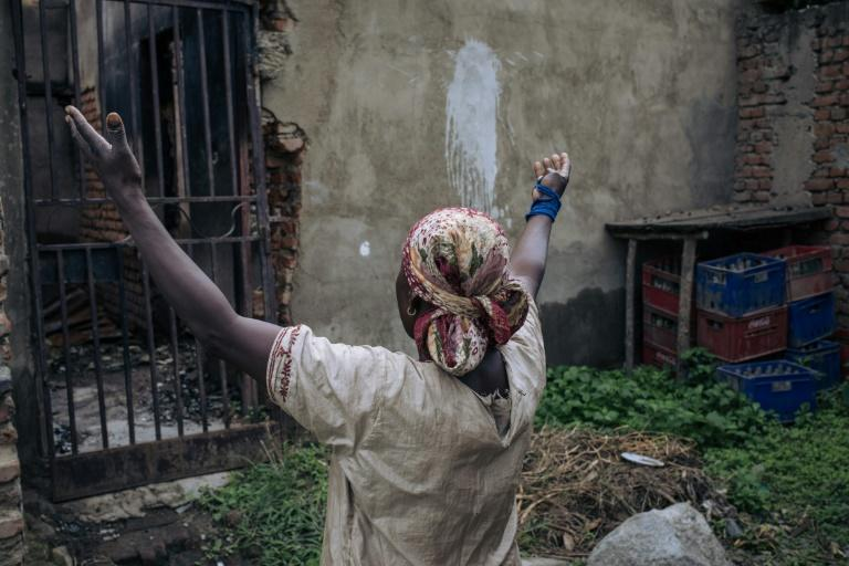 Desolation: Fabiola Mbambu Kambere survived an attack on the village Nzenga but her home was destroyed