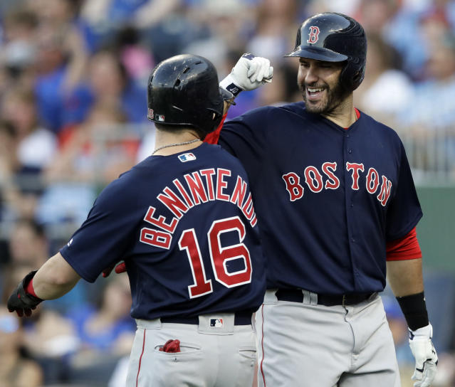 Boston Red Sox designated hitter J.D. Martinez, right, is congratulated by Andrew Benintendi after his solo home run during the second inning of the team's baseball game against the Kansas City Royals at Kauffman Stadium in Kansas City, Mo., Friday, July 6, 2018. (AP Photo/Orlin Wagner)
