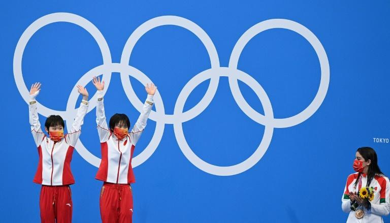 Teenagers Chen Yuxi and Zhang Jiaqi showed no nerves in winning another diving gold for China in Tokyo