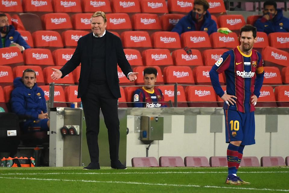 Barcelona's Dutch coach Ronald Koeman gestures during the Spanish league football match between FC Barcelona and Valencia CF at the Camp Nou stadium in Barcelona on December 19, 2020. (Photo by LLUIS GENE / AFP) (Photo by LLUIS GENE/AFP via Getty Images)