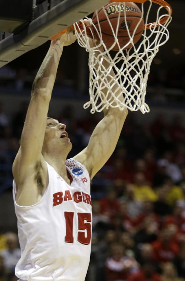 Wisconsin forward Sam Dekker (15) dunks during the first half of a third-round game against the Oregon of the NCAA college basketball tournament Saturday, March 22, 2014, in Milwaukee. (AP Photo/Jeffrey Phelps)