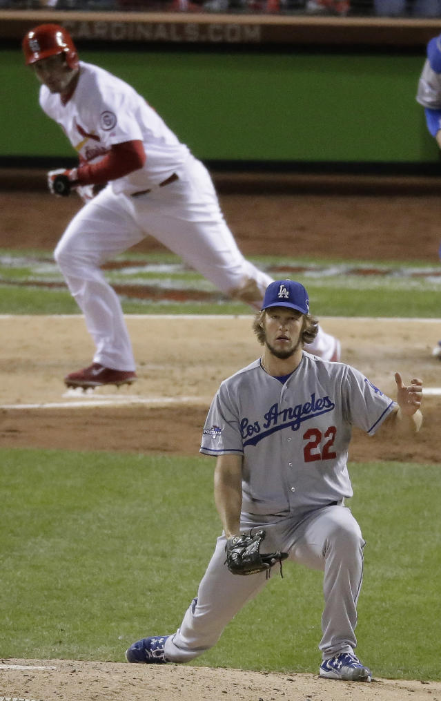 Los Angeles Dodgers starting pitcher Clayton Kershaw watches as St. Louis Cardinals' David Freese hits a single during the third inning of Game 6 of the National League baseball championship series Friday, Oct. 18, 2013, in St. Louis. (AP Photo/Chris Carlson)