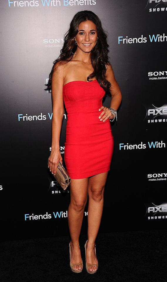 """Right behind Emma in the arrivals line was """"Entourage"""" beauty Emmanuelle Chriqui, who nearly stole the spotlight in a bright red bustier dress. That said, I have to dock her a few points for those clunky wedges! Jamie McCarthy/<a href=""""http://www.wireimage.com"""" target=""""new"""">WireImage.com</a> - July 18, 2011"""