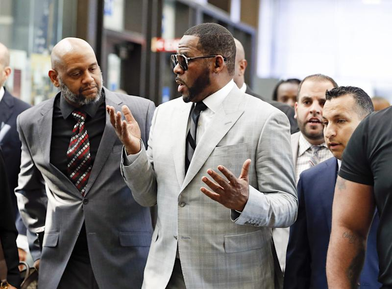 R. Kelly arrives at the courthouse in Chicago on June 6, 2019, to be arraigned on 11 new charges of criminal sexual abuse.