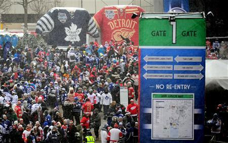 NHL fans wait outside gate one prior to the start of the 2014 Winter Classic hockey game between the Toronto Maple Leafs and Detroit Red Wings at Michigan Stadium. Mandatory Credit: Andrew Weber-USA TODAY Sports