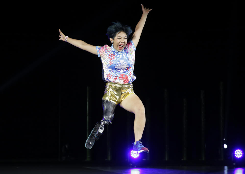 "Kaede Maegawa, a Paralympian, participates in a fashion show dubbed ""Amputee Venus Show"" in Tokyo on Tuesday, Aug. 25, 2020. The fashion show was held in conjunction with the opening of the Tokyo Paralympic Games, now scheduled to open on Aug. 24, 2021. (AP Photo/Hiro Komae)"