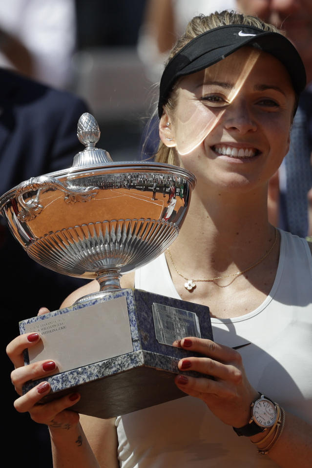 Ukraine's Elina Svitolina holds the trophy after winning her final match against Romania's Simona Halep at the Italian Open tennis tournament, in Rome, Sunday, May 20, 2018. Svitolina won 6-0, 6-4. (AP Photo/Gregorio Borgia)